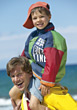 Boy Sitting on Dad's Shoulders stock photo