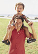 Boy Sitting on Mom's Shoulders stock photography