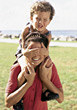Boy Sitting on Mom's Shoulders stock photo
