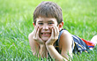 Boy Smiling Laying in Grass stock photography