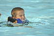 Boy swimming with eyes shut