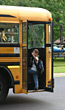 Boy Waving Goodbye Getting on Bus