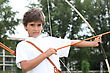 Boy With A Bow And Arrow stock image