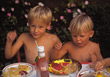 People Eating  Boys Eating At A Picnic stock photography