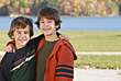 Boys in Front of the Lake in the Fall stock image