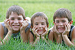 Boys Laying in Grass stock photography