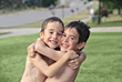 Boys Playing Around Hugging stock image