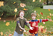 Playful Boys Playing in the Leaves stock photo