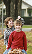 Small Boys Playing in the Leaves stock photo