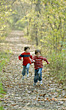 Boys Running on a Path in Woods stock photography