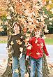 Boys Throwing Leaves stock photo