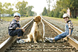 Boys With Dog on Railroad Tracks stock image