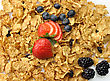 Bran And Raisin Cereal With Fruits And Berries stock image