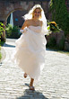 Wedding Bride in Gown Running to Her Wedding stock photo