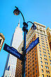 Broadway Sign And Empire State Building In New York City stock image