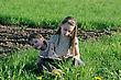 Brother And Sister Enjoy Summer Time In The Green Grass