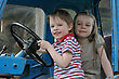 Brother And Sister First Time In Tractor Cab stock photo
