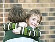 Brothers Hugging stock image