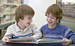 Brothers Reading Together stock image