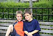 Brothers Sitting on A Bench stock photo