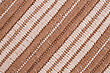 Brown And White Knitted Cloth As A Background stock photography