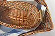 Brown Wicker Basket With A Blue Gingham Cloth For Table Appointments stock photography