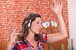 Brunette Dancing Wearing Headphones stock photo
