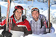 Snowboarding Buddies At Ski Resort stock photo