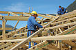 Builders Working On The Roof Of A Large House stock photography