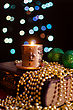 Burning Candle And Seasonal Decorations On Bokeh Lights Background stock image