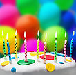 Burning Candles On A Birthday Cake On The Background Of Balloons stock photography