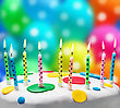 Burning Candles On A Birthday Cake On The Background Of Balloons stock photo