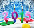 Burning Candles With The Symbol Of The New Year 2015 On The Cake stock photo