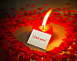 Burning Heart Shaped Candle And A Card With 'I Love You' Writing stock image