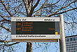 Waiting Bus Stop Sign On Blue Sky Background In Berlin, Germany stock photo