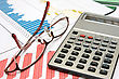 Business Balance. Calculator,glasses And Charts On The Desk stock photography