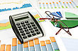 Business Concept. Colorful Charts, Calculator And Glasses stock photography