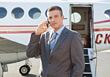 Business Man on Cell Phone with Airplane stock image