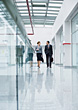 Business Man & Woman Walking Down Hallway stock photo