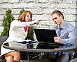 Business Partners Meeting: Male And Female With Laptop Sitting Outdoors stock photography