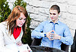 Business Partners Meeting: Male And Female Sitting Outdoors. Focus On Female. stock photography
