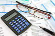 Business Reports With Calculator,eyeglasses And Pen stock photography