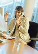 Business Woman in the Office on the Phone stock photography
