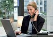 Business Woman On Telephone & Working On Laptop stock photography