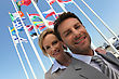 Businessman And Woman By Flags stock image