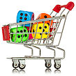 Buying Games. Shopping Cart With Colorful Dice Inside stock photo