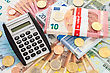 Calculator With Euro Banknotes And Coins. Finance Concept stock photo