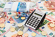 Calculator With Euro Notes And Coins. Finance Concept stock photo