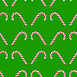 Candy Cane Icon Isolated On Green Background. Christmas Seamless Pattern