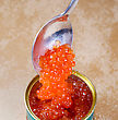 Canned Salmon Red Caviar With Spoon Closeup